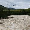 A rain-swollen Baliem River leaps its banks.