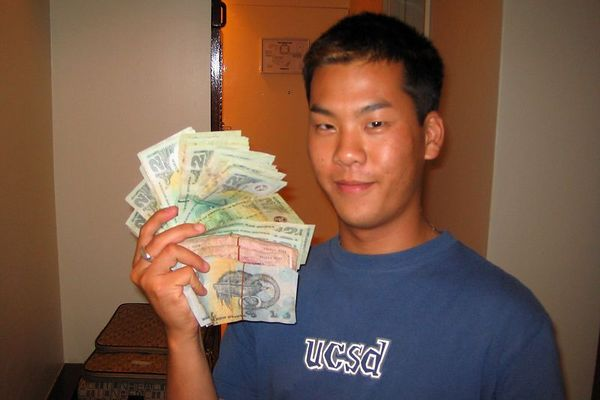 Son Ly with wads of small kina bills