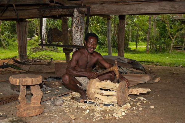 A wood carver under his house