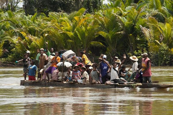 A motorized canoe holds no fewer than 27 passengers, plus cargo.