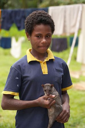 A girl holds a pet couscous