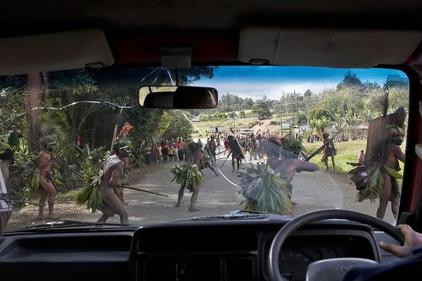 A mock battle in the middle of the road (preparing for the Mt. Hagen Show)