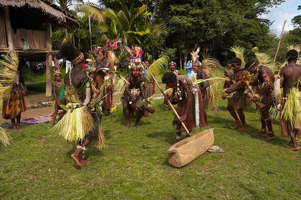 Villagers perform in a fish dance