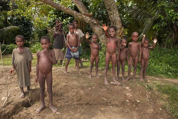 Kids bid us goodbye from the bank of the Karawari