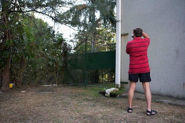 Doug Ebersole photographs razor wire at the Holiday Inn in Port Moresby