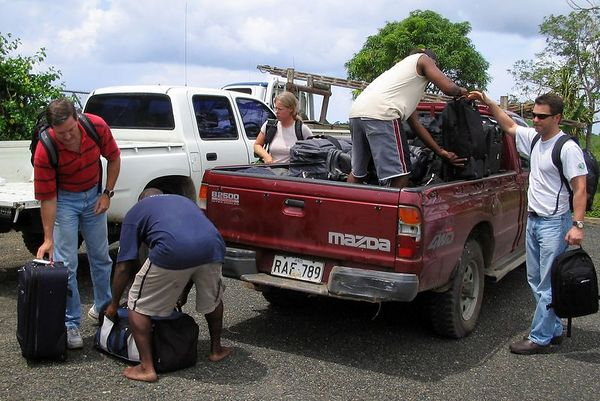 Loading luggage onto the truck, in Kavieng