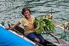 Papua New Guinea. Milne Bay: Village girl in canoe