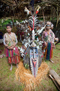 Large headdress covering entire body of a Sepik River tribe at the Crocodile Festival