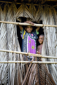 Young kids inside a local village hut near the Sepik