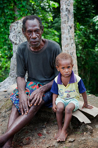 Man and boy on the road from Wewak to Sepik