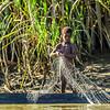 Papua New Guinea boy pulls up a fishing net. Taken in East Sepik region.