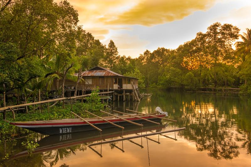 Sunset near the river mouth at Warironi Village, Papua, Indonesia, October 2015. [Papua Warironi 2015-10 13 YapenIs-Indonesia]