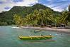 A coastal motorized outrigger canoe rides the waves moored at Tabla Nusu near Depapre, Papua, Indonesia, March 2009. [Papua Depapre 2009-03 040 Indonesia]
