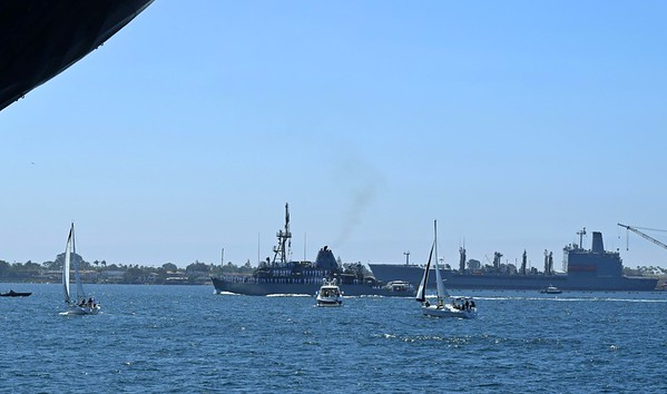 USS Champion MCM-4, small Coastal Patrol Boat, passing an Oiler at North Island
