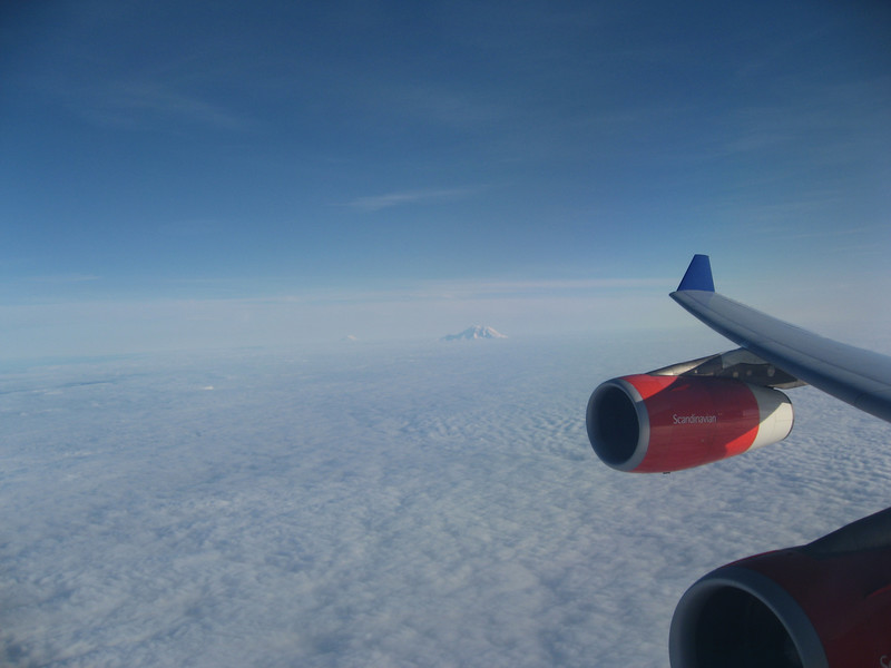 Looking down the wing of a A340 at Mt. Rainier in the distance