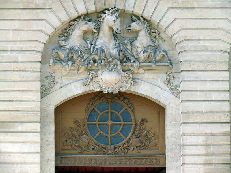 Stables- detail above entrance doorway. Chantilly.