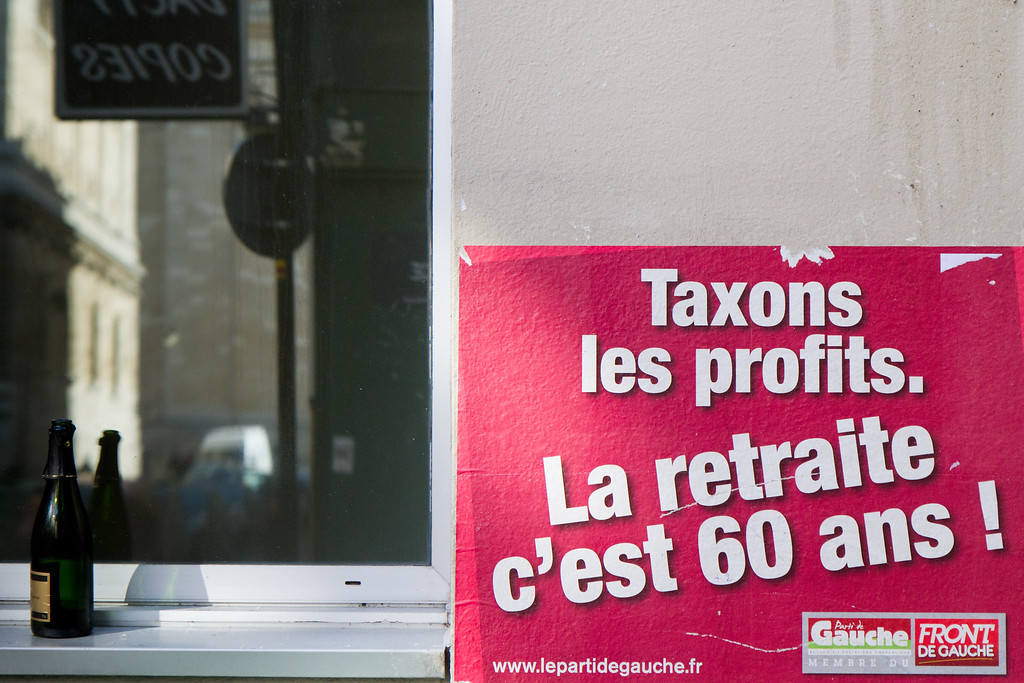 """Tax the Profits. Keep the retirement age at 60"" this poster states, which was the basis of the strikes in the fall of 2010."