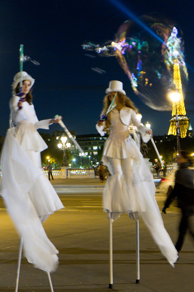 Along the Seine, upriver from the Eiffel tower, there was an opening of an art exhibit that featured these young woman on stilts blowing large bubbles to attract passersby.