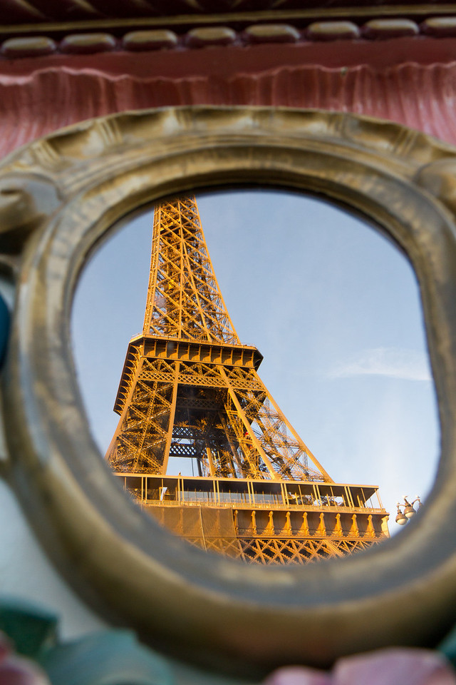 Reflection of the Eiffel tower as seen in a mirror on a nearby carousel