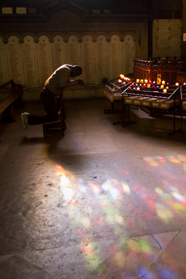 A worshipper bows inside St Sulpice