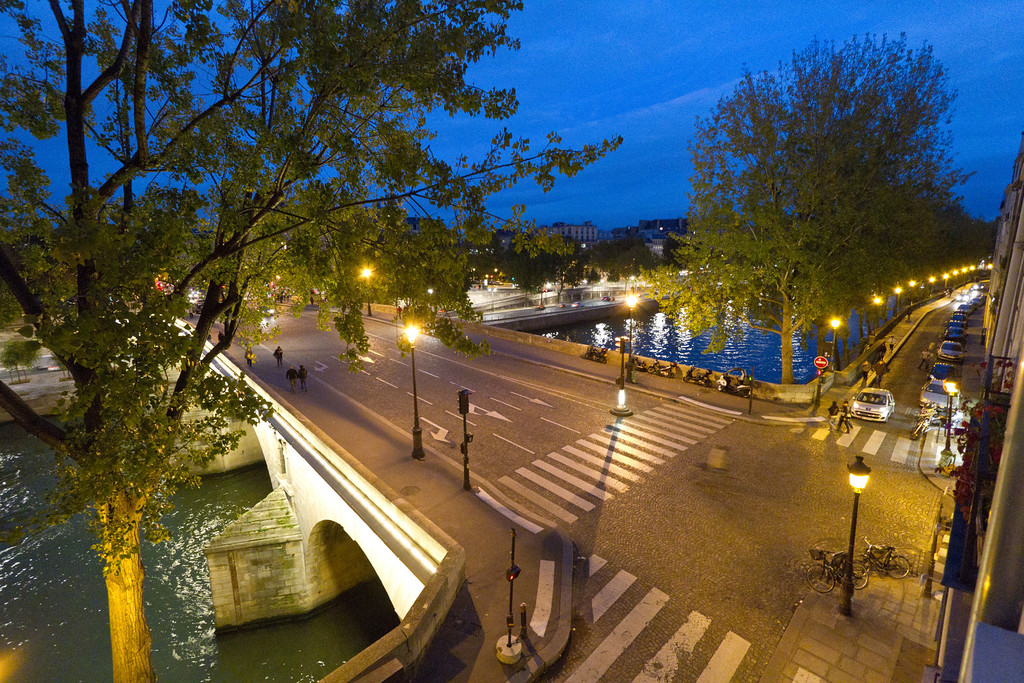 The view out our living room window. The bridge over the Seine river connects the isle to the right bank.