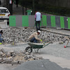 Street repair near the Arc.  These guys are chipping out block by block of the cobblestone? street.