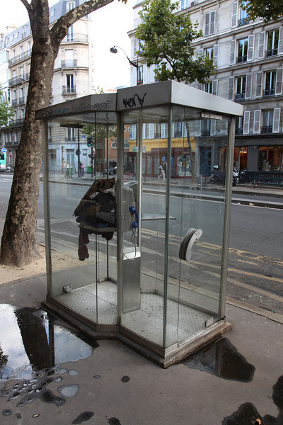 Some people actually SLEEP in these phone-booths, and leave their clothes in there...
