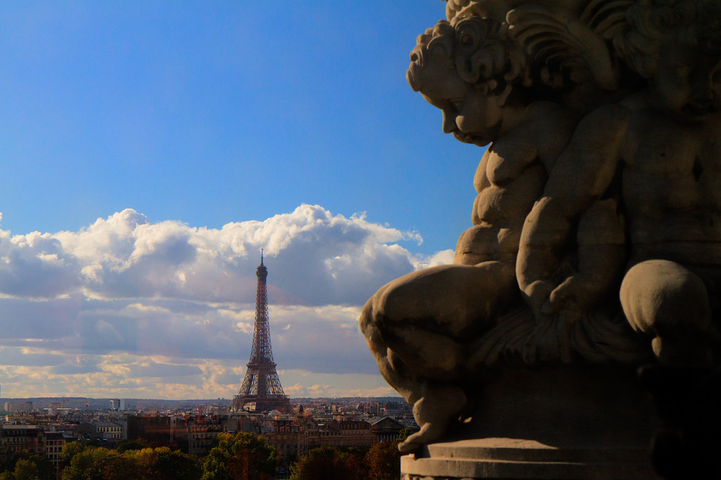 On the top floor of the Museum of Decorative Arts was this vista of the Eiffel tower seemingly being gazed upon by cherubs