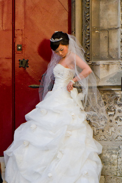 This poor freezing bride was posing for wedding pictures along the side door of Notre Dame. The temperature was in the 40's