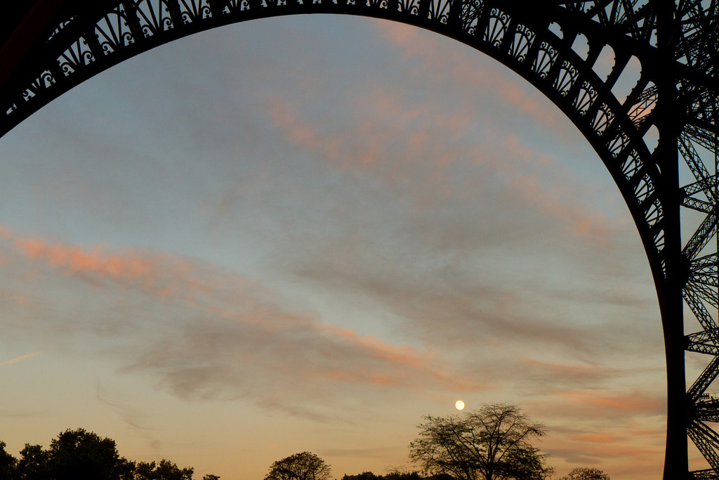 Moonrise at sunset from under the Eiffel tower