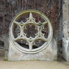 Rose window on display in courtyard of Hotel de Sully