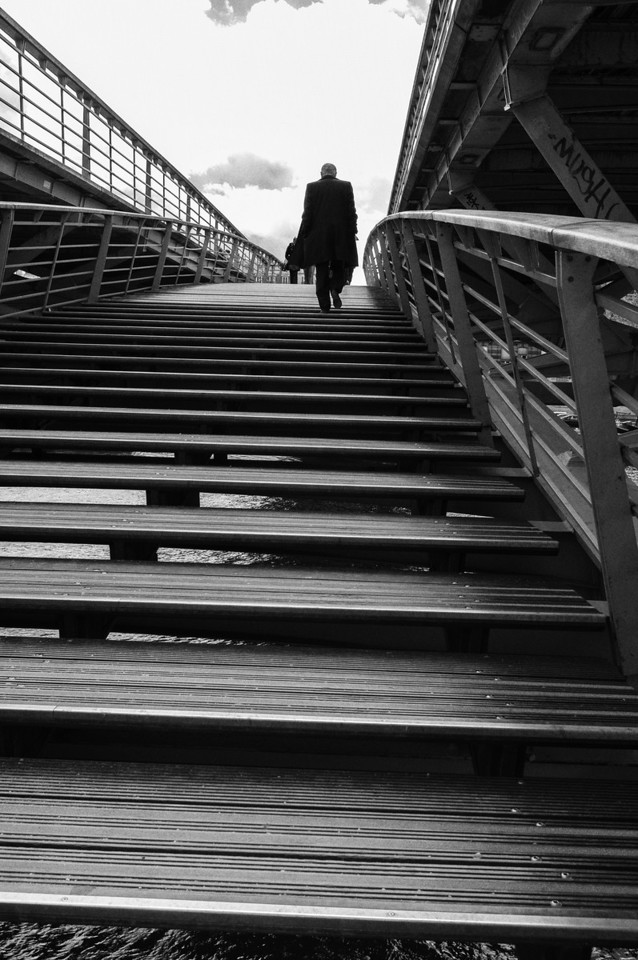 Ascending a pedestrian bridge over the Seine