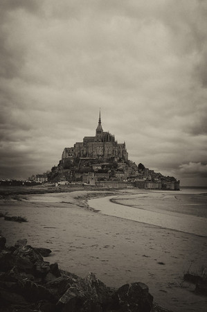 Mont St Michel at daybreak. At the junction of Normandy and Brittany, the ancient abbey and fortress are built on a granite spit of land just off the coast.