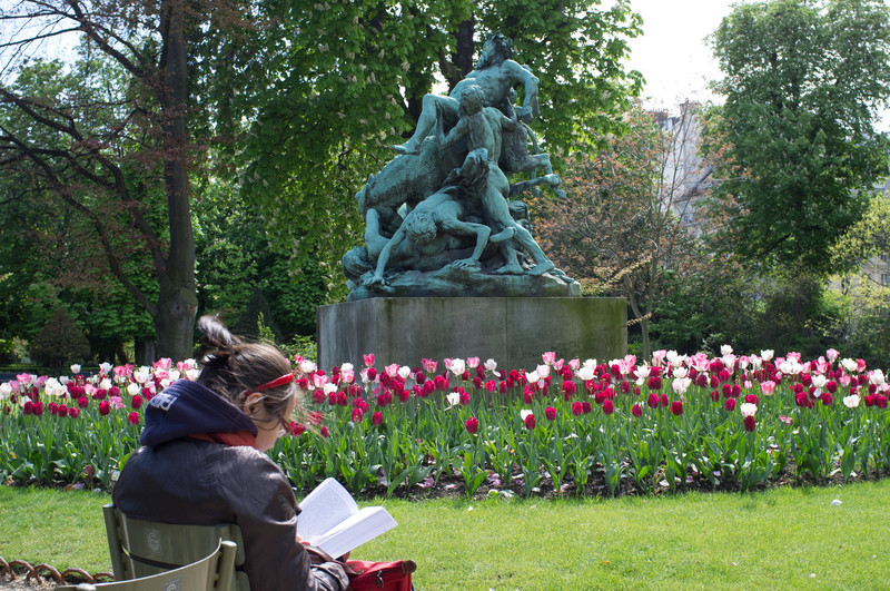 In the Luxembourg garden, tulips were the main flower in bloom. The statue in the back is of bacchus debauched and having fun of some sort.
