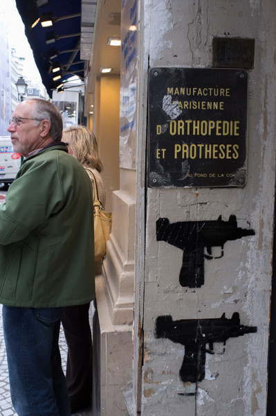 Strange juxtaposition of a manufacturer of orthopedic equipment and prostheses, and icons of guns. Or is it a coincidence?