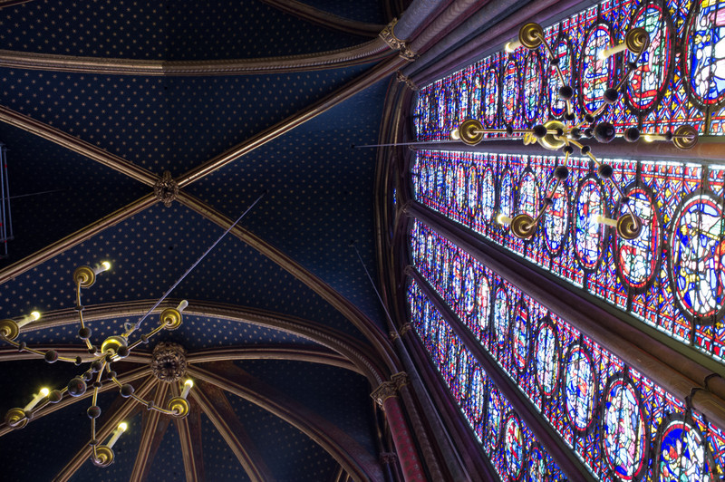 Saint Chapelle, built near Notre Dame in the 1200's, has one of the best examples of 13th century stained glass in the world. These panels, some 50 feet tall, tell the story of the bible in graphic form to the illiterate people of the time. In essence at 13th century graphic comic strip.