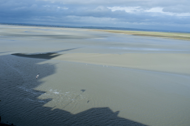The shadow of the abbey on the incoming tidal flow