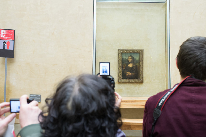 The Mona Lisa always has a crush of people around her. She is so well protected that visitors can't get close enough to admire her. Most simply snap a photo and move on. She seems amused by the commotion.
