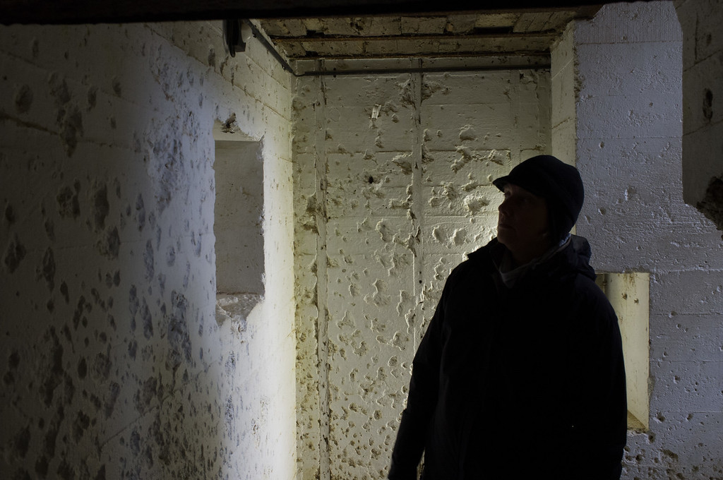 Signs of battle in a German bunker; the walls are still scarred by bullet holes