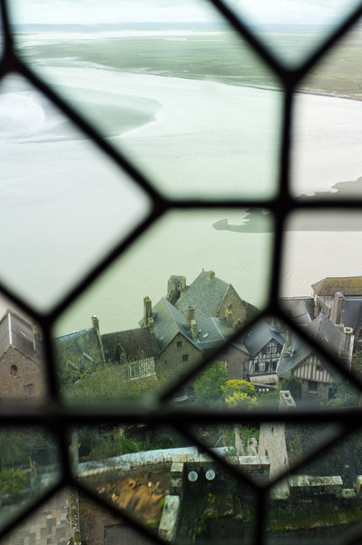 The small village on the Mont, as seen through the ancient stained glass of the Abbey
