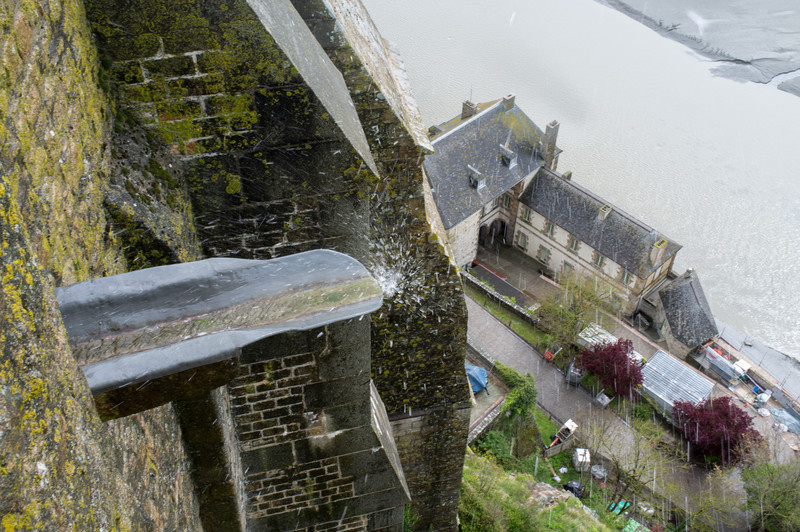 From the Abbey looking down, strong winds blow runoff from the gutter back up toward me.