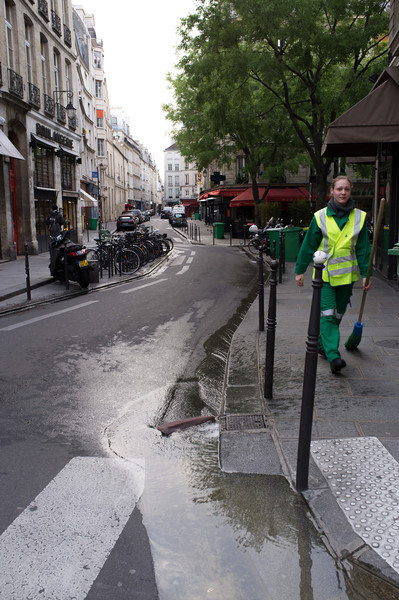 In general Parisians are not early risers. Early morning streets belong to the commercial trucks and squads of street cleaners. They open up small faucets in the curbs, and sweep debris into the flow of water that ensues. The streets are much cleaner now than in the 1980's, when we first visited. They also have a lot better water supply than San Diego. Our local boulangerie shop is on the left.