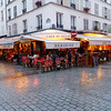 Paris - one of the Cafes on Rue Cler on a rainy evening.