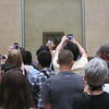 The Louvre - the usual crush of tourists in front of the Mona Lisa.