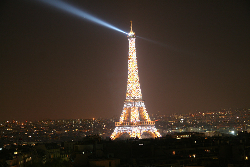 Paris - Eiffel Tower with strobe lights firing.
