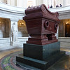 "Napoleon's Tomb at the Invalides Army Museum.  The railing at the upper part of the photo is designed so that people have to lean to see the tomb, which is by design as that provides the same effect as people continuing to ""bow"" to Napoleon."