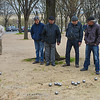 Men playing Bocce in park Paris