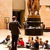Paris schoolkids on a teaching field trip to the Musee d'Orsay, sketch pads and all.