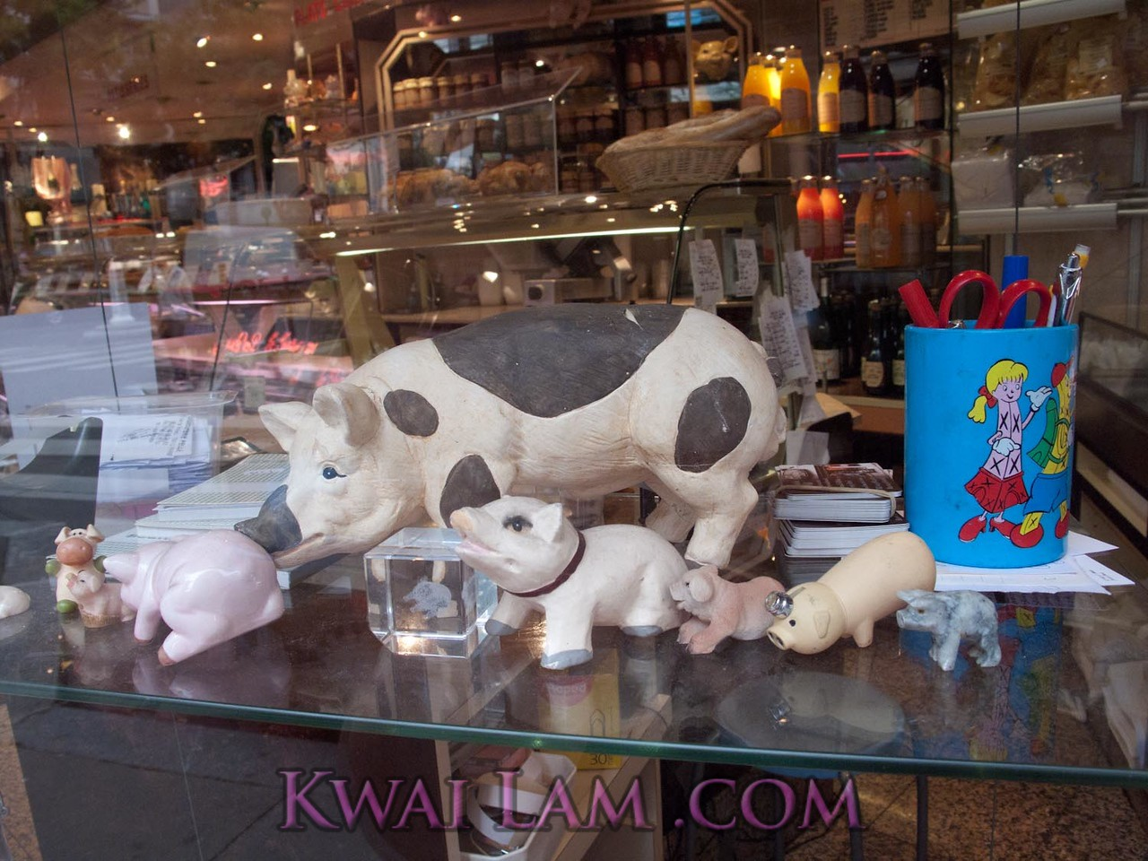 Pigs in the window. Humor? Altar? Delectables at Charcuterie Pelle, 13th Arrondisment, Paris.