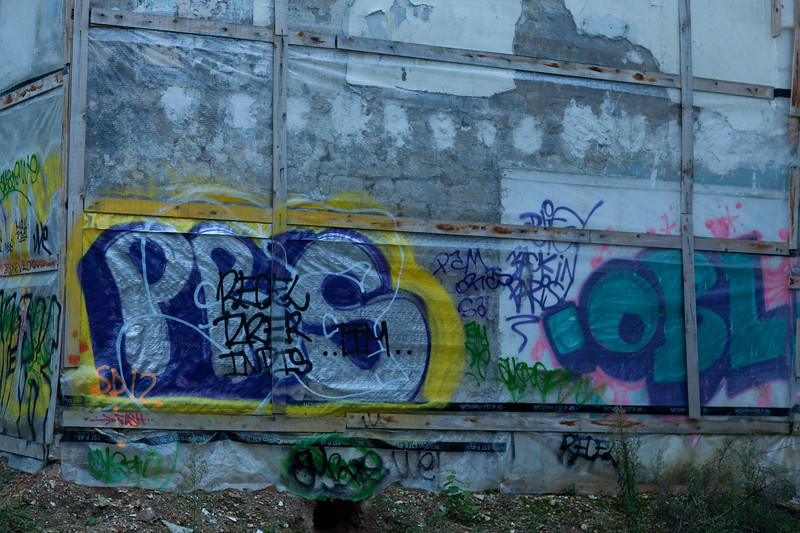 More graphitti, across the street, at the back of an empty lot.